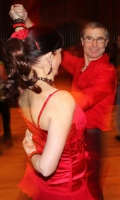 Salsa party showcase dance performed by Philippe with dance partner Jacqueline